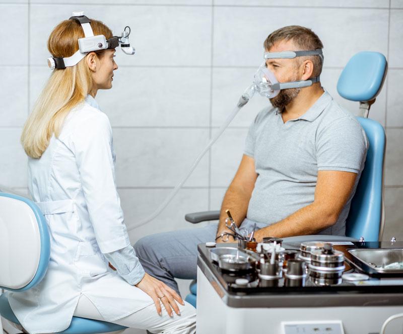 dentist-consulting-sleep-apnea-patient